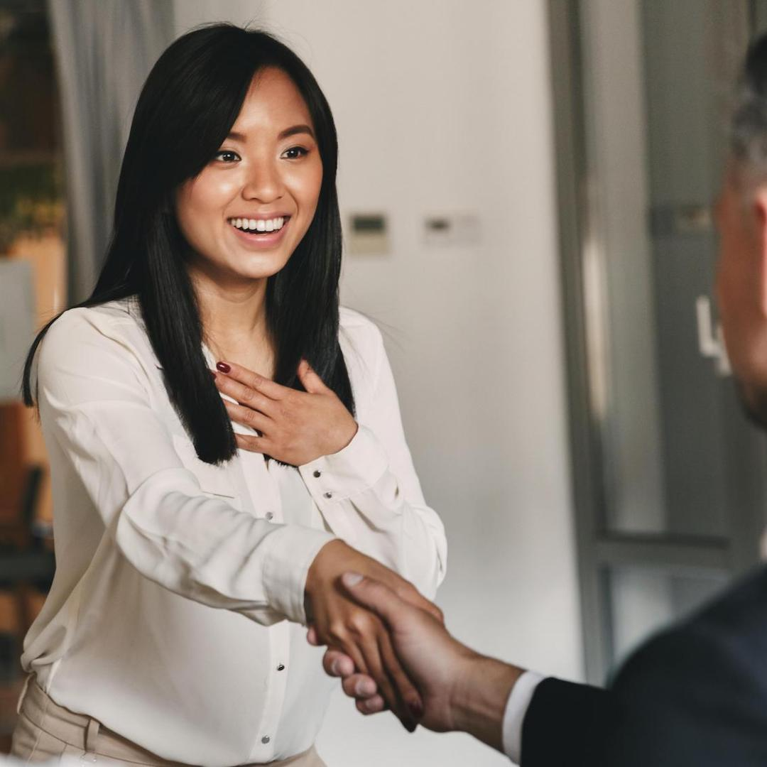 asian legal assistant shaking the hand of a client