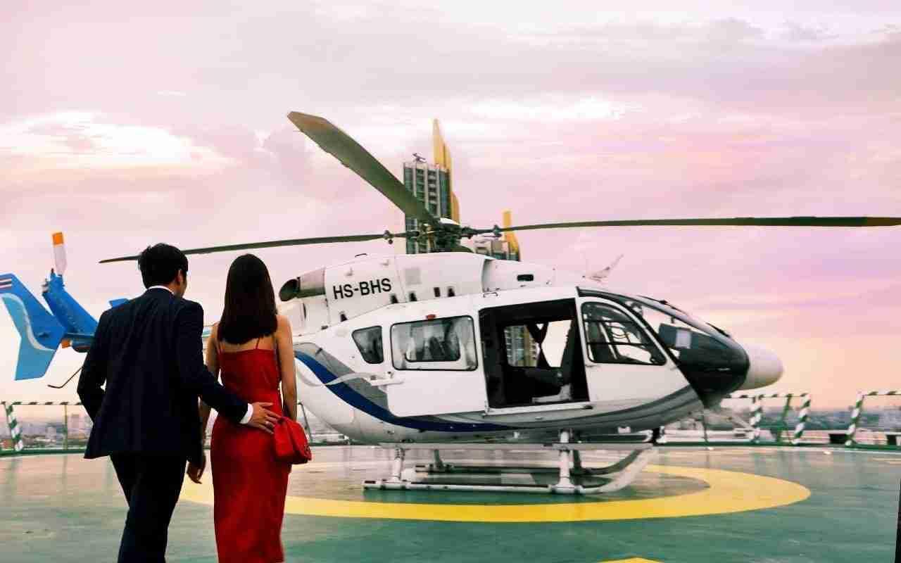 couple at the helipad of the peninsula hotel in Bangkok