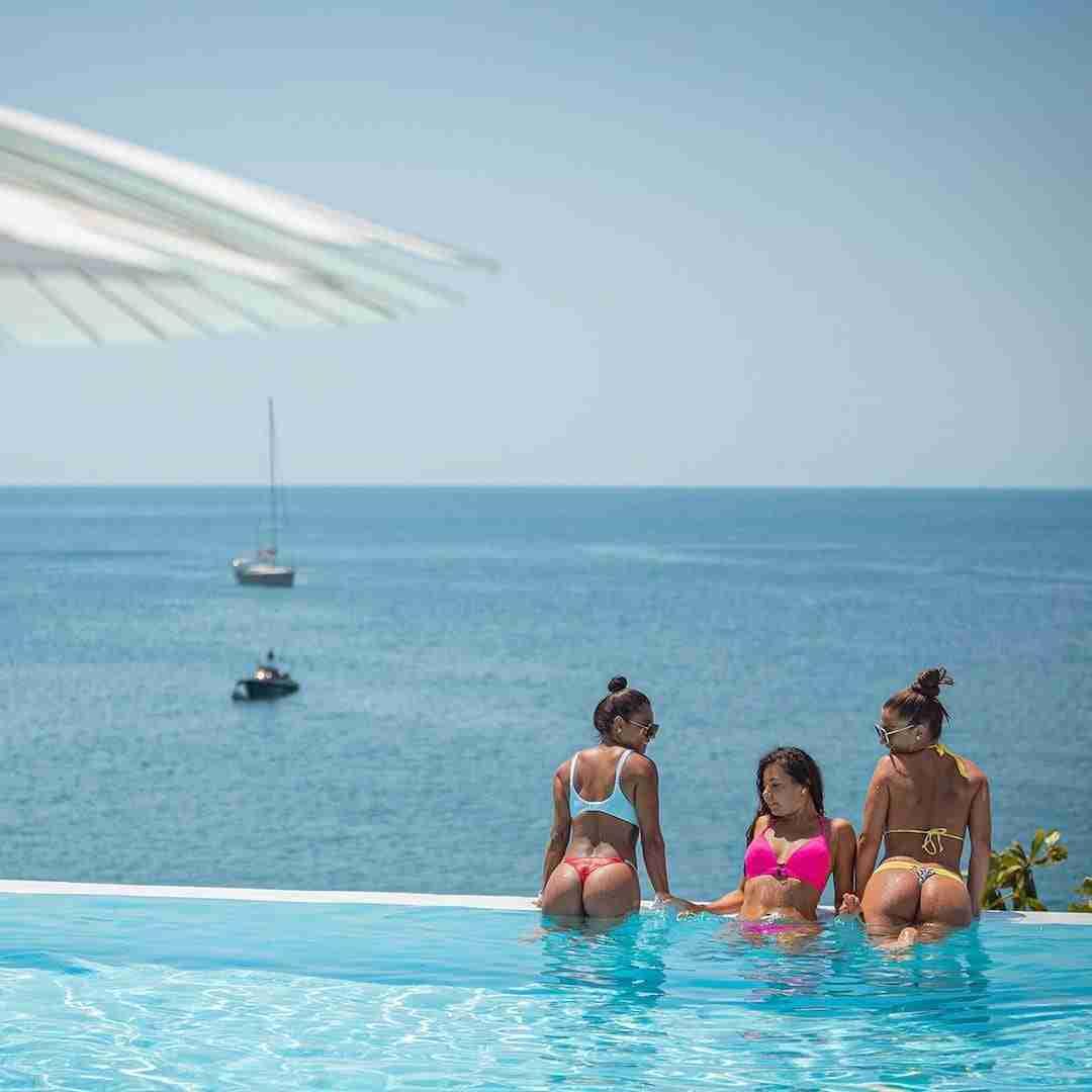 girls in bikini in a infinite pool in Thailand