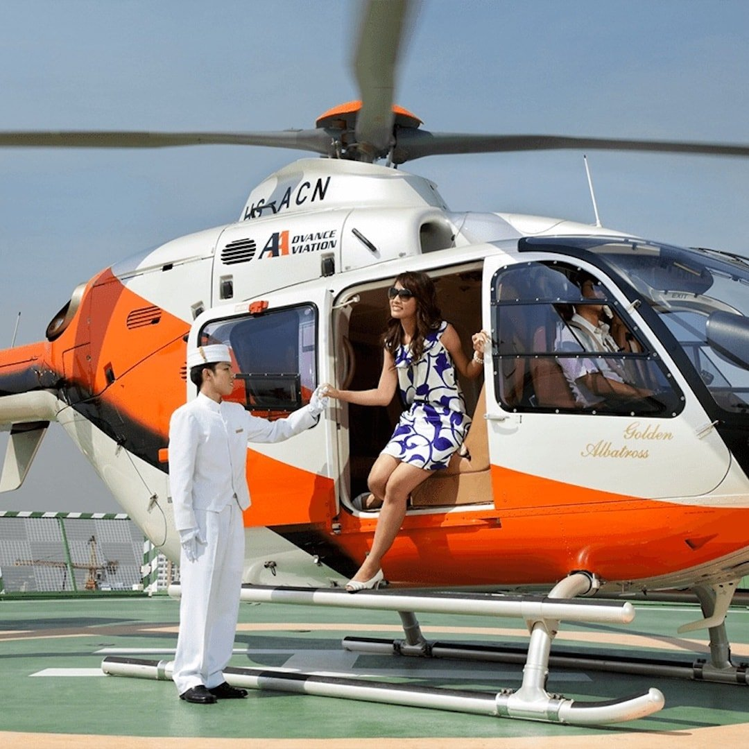 vip customer getting out of an helicopter in Bangkok