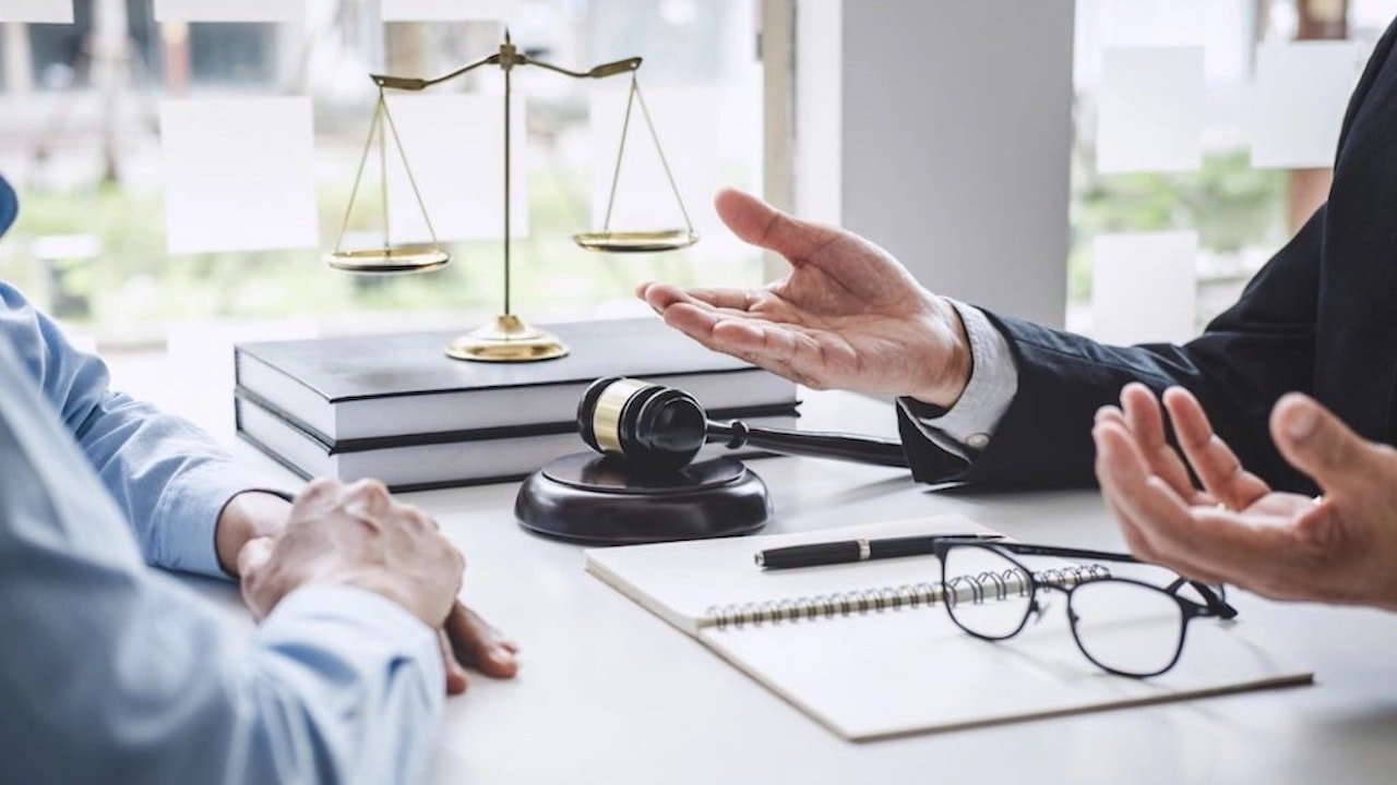 lawyer talking to a client with his hands open