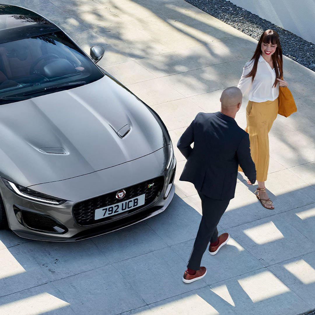jaguar luxury car with a couple