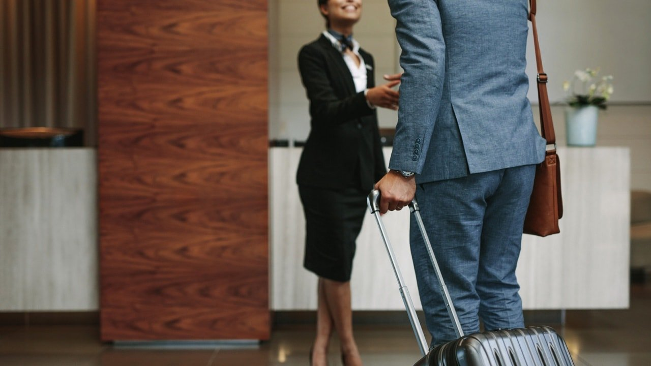 luxury concierge service in Thailand with a women welcoming a wealthy male client