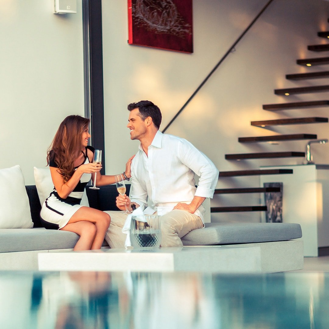 couple drinking in a duplex apartment in Thailand