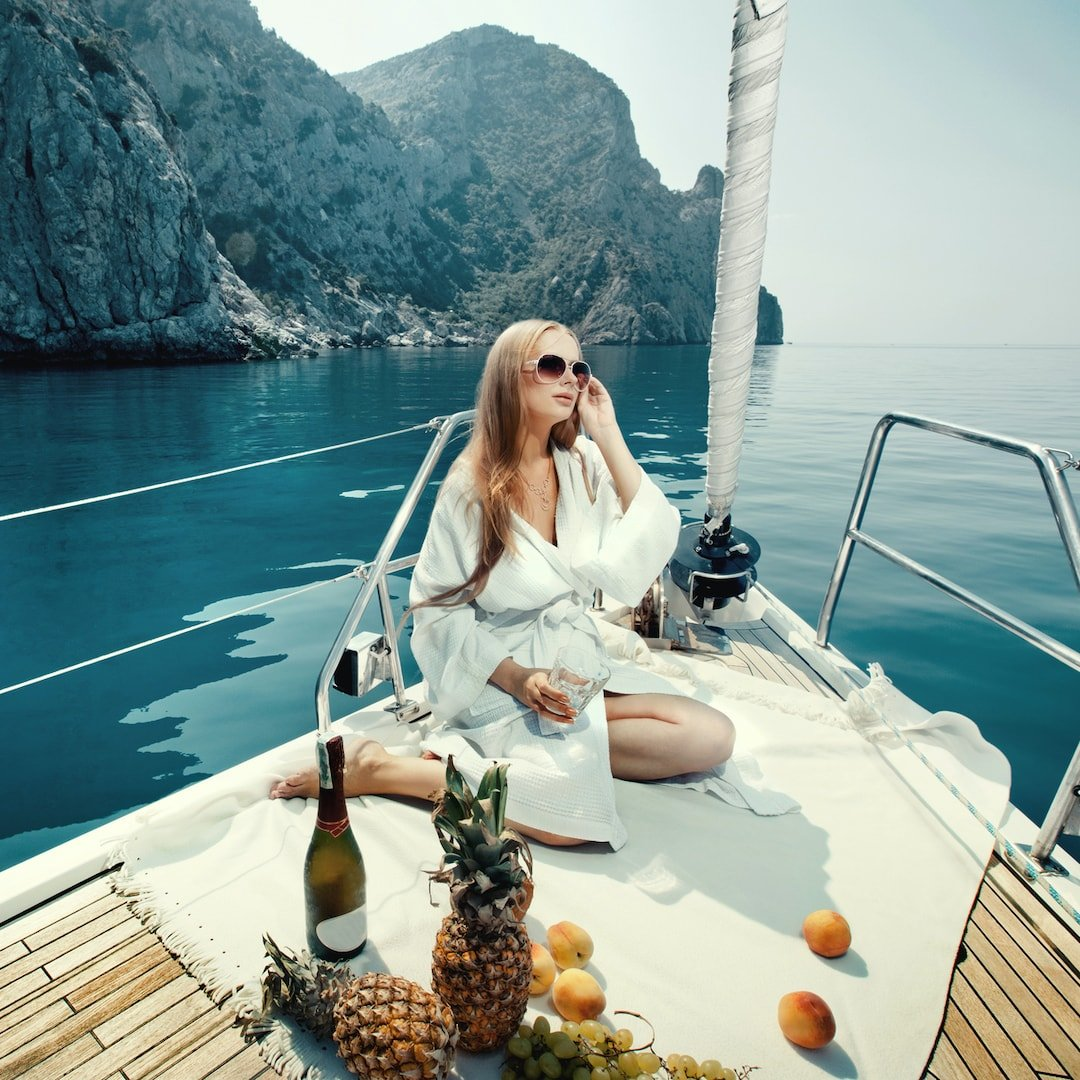 girl enjoying drinks and food on a luxury yacht in Thailand