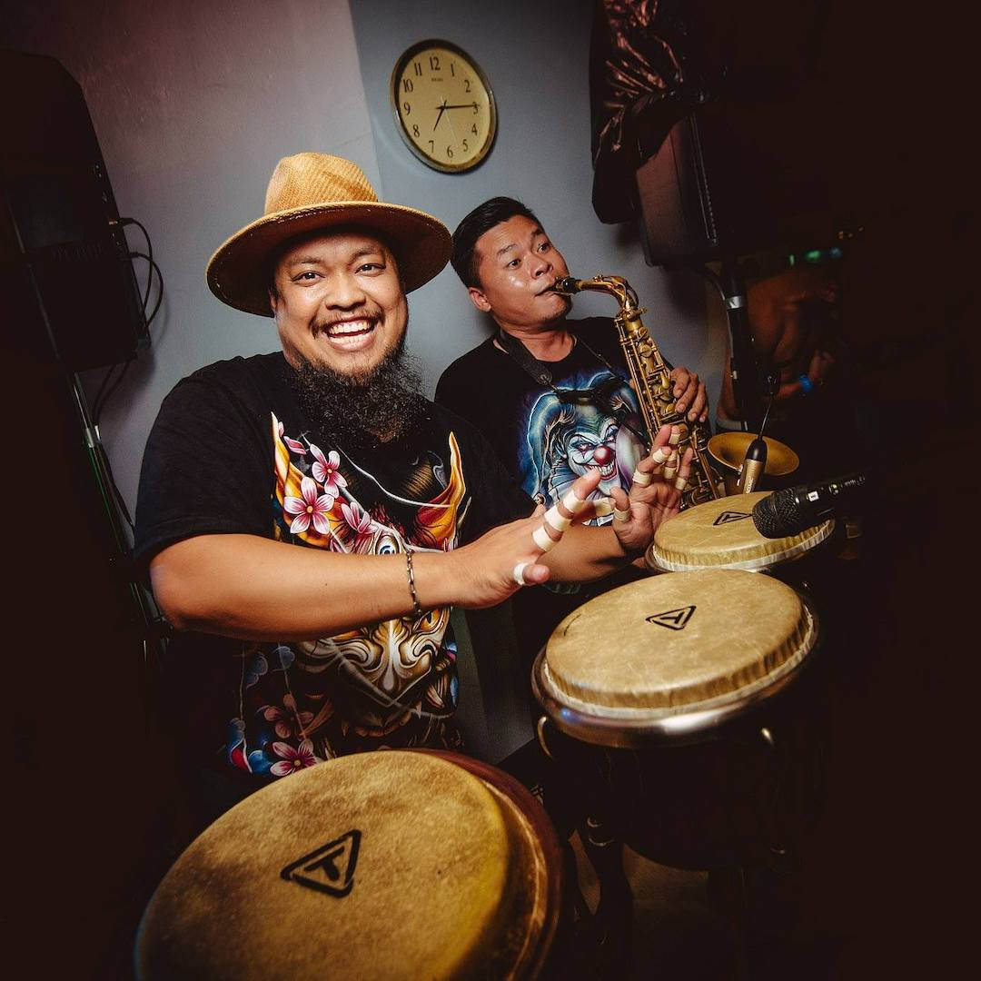 Thai musicians playing percussions at a private party in Bangkok
