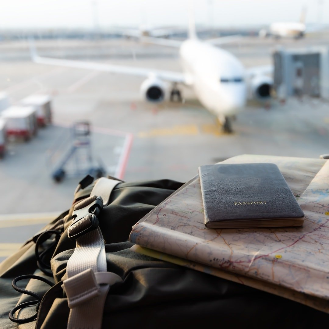 passport on a bag with an airplane in the background