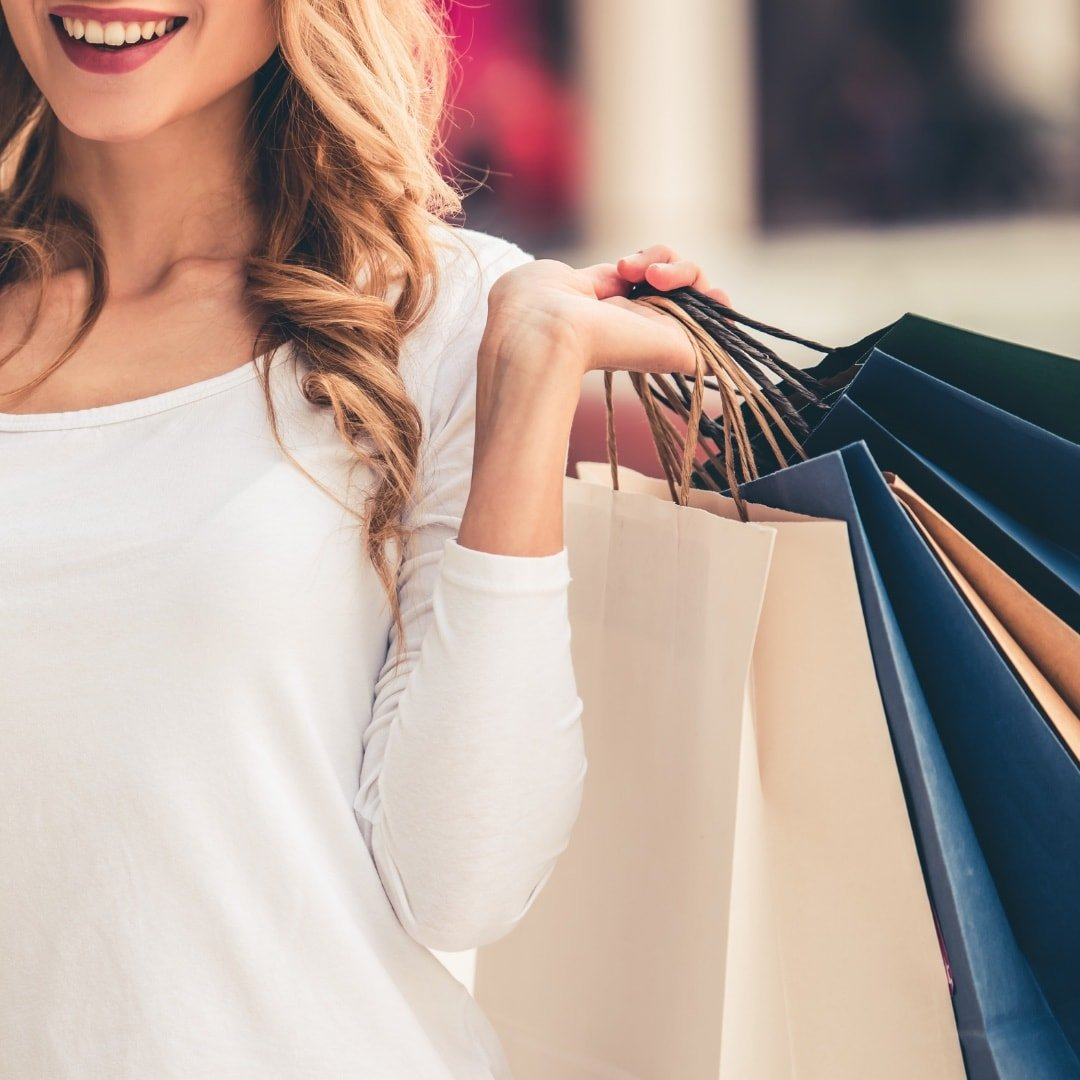 personal shopping assistant with shopping bags