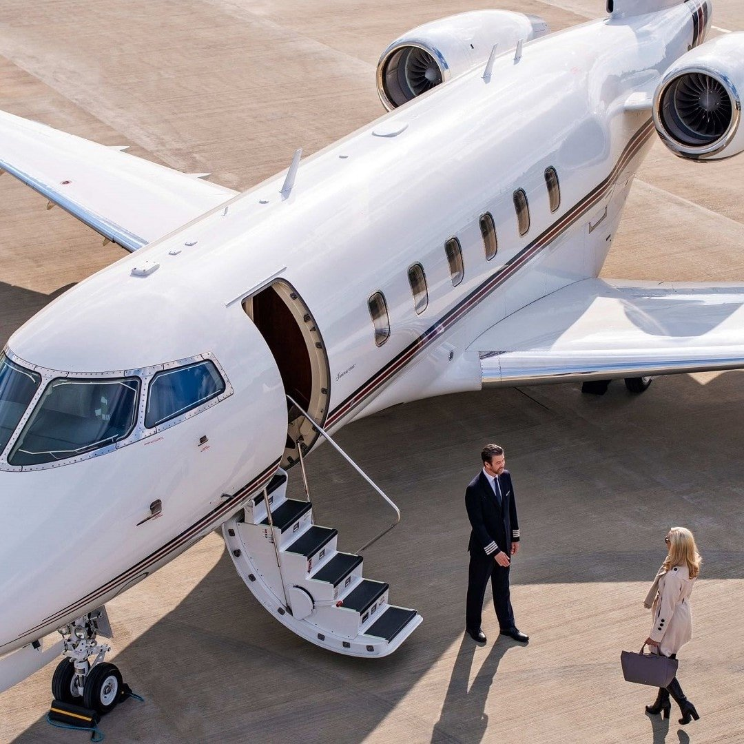 woman getting aboard a private jet in Thailand
