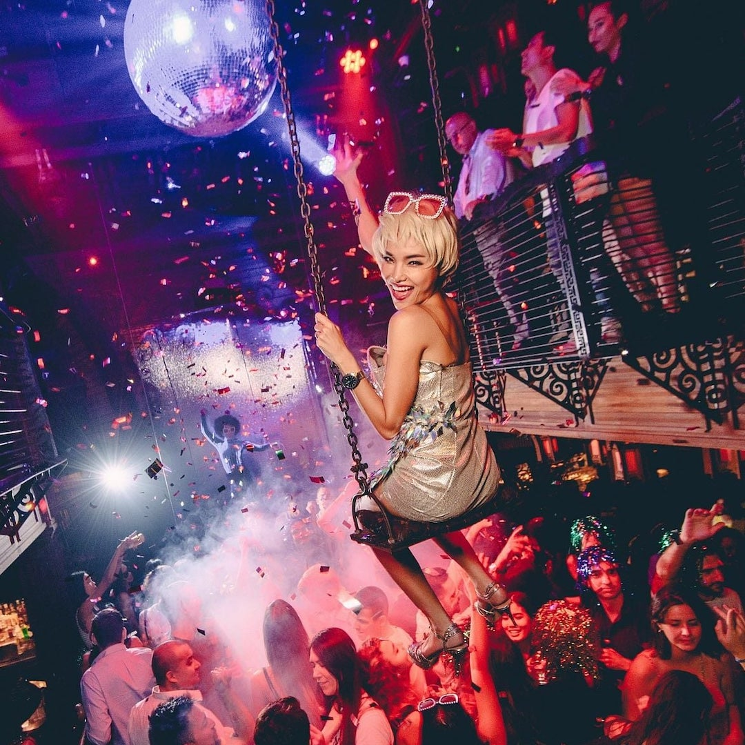 extravagant party with beautiful girl on a swing at Sing Sing Theater club in Bangkok
