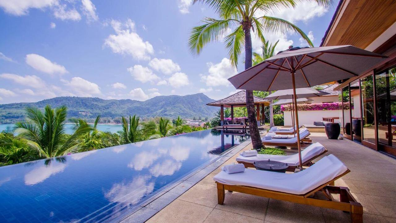 luxury pool villa in Phuket Thailand with infinite pool sunbeds and sea view