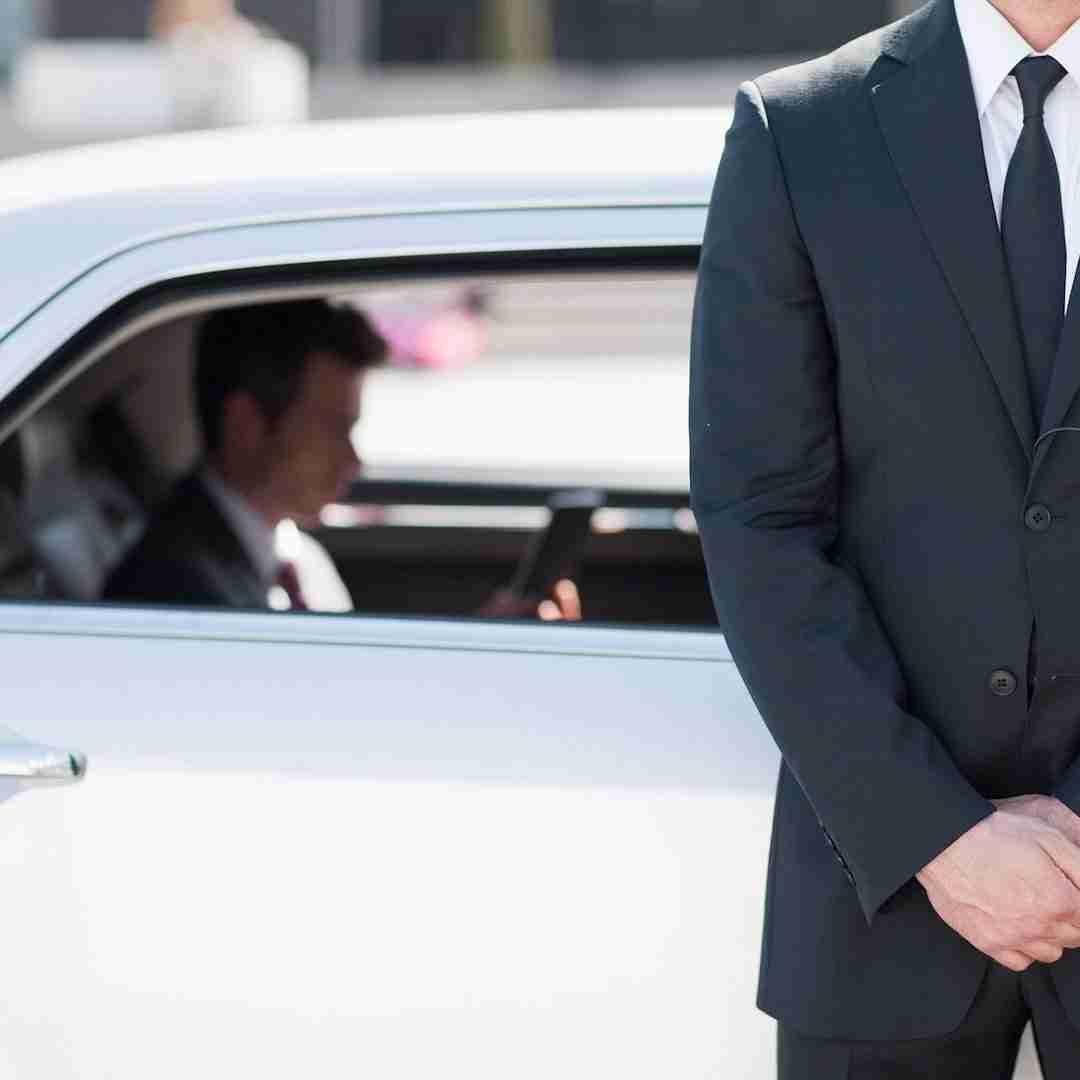 vip concierge next the his clients car